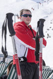 Young man skiing. Sportsman taking a deep breath after skiing Royalty Free Stock Photo