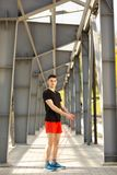 Young man skipping with jump rope outdoors. Exercising and lifestyle concept.  royalty free stock photos