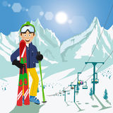 Young man with skis and poles standing in front of mountains with ski chair lift and bright sun in ski resort. Young man with skis and poles standing in front of Stock Image