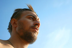 Young man with the sky above Stock Photography
