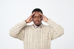 Young man, slapping hand on head having a duh moment isolated on gray background. Negative human emotion facial expression. African young man, slapping hand on royalty free stock photos