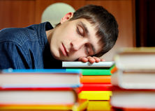 Young Man sleep on the Books. Tired Young Man sleep on the Books at the Home Stock Images
