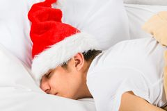 Young Man sleep in Santa Hat stock photo