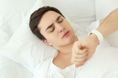 Young man with sleep tracker lying Royalty Free Stock Photography