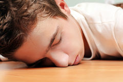 Young Man Sleeping. On the Table in Home inerior Stock Photography
