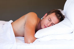 Young man sleeping Stock Photography