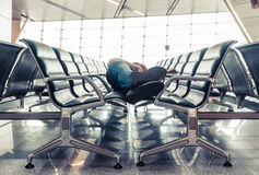 Young man sleeping at the airport Royalty Free Stock Image