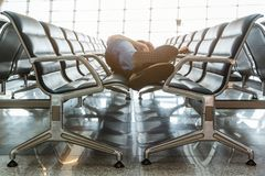 Young man sleeping at the airport. While waiting for delayed flights stock photo