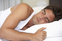 Young Man Sleeping On Bed Royalty Free Stock Image