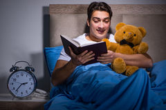 The young man sleeping in the bed Royalty Free Stock Photos