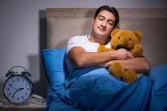 The young man sleeping in the bed Stock Image