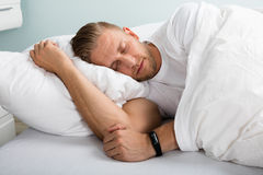 Young Man Sleeping On Bed Stock Photography