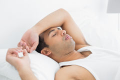Young man sleeping in bed Royalty Free Stock Images