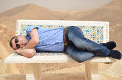 Young man sleeping on a bench Royalty Free Stock Photography