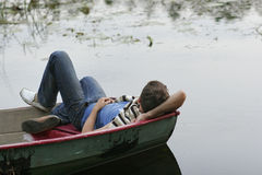 Young man sleeping on  boat Royalty Free Stock Images