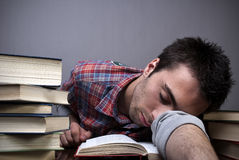 Young man sleeping on books Stock Images
