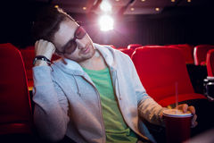 Young man sleeping in chair Royalty Free Stock Photos