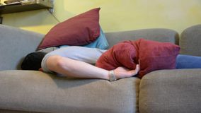 Young Man Sleeping on the Couch at Home stock video