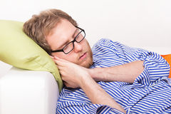 Young man sleeping on the couch Stock Photo