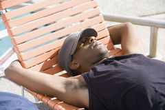 Young Man Sleeping On Deck Chair Royalty Free Stock Photography