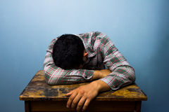 Young man sleeping at desk Royalty Free Stock Image