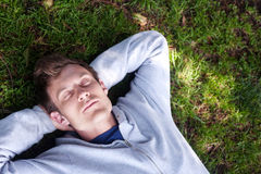 Young man sleeping in the grass Stock Photo