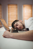 Young man sleeping in office. Young man sleeping on desk in office Stock Photos