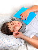 Young Man sleeping. Young Man sleep on the Couch with the Books Stock Photography