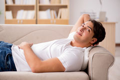 The young man sleeping in sofa couch Royalty Free Stock Photo