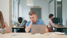 Young man sleeping at workplace. Portrait of business man falling to sleep. stock footage