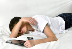 Young Man sleeps with Tablet Computer Royalty Free Stock Images