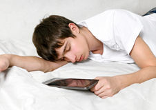 Young Man sleeps with Tablet Computer Stock Photos