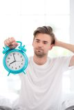 Young man slept the day away Stock Images