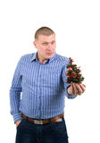 Young man with small christmas tree Royalty Free Stock Photos