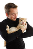 Young man with a small kitten Royalty Free Stock Photos