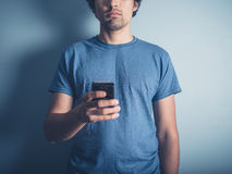 Young man with smart phone Stock Photos