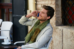 Young man with smartphone in an cafe outdoor Stock Photo