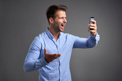 Young man with a smartphone Royalty Free Stock Image