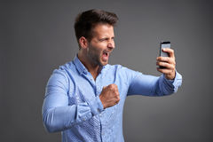 Young man with a smartphone Royalty Free Stock Photo
