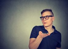 Irritated man using voice service stock photos