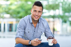 Young man with smartphone Royalty Free Stock Photos