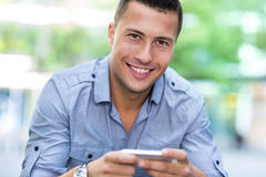 Young man with smartphone Stock Photography