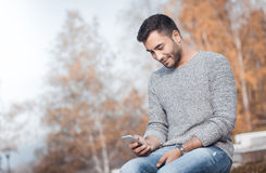 Young man with smartphone Royalty Free Stock Photo