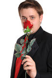 Young man smelling rose Royalty Free Stock Photos