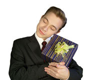 The young man with a smile an embracing gift Royalty Free Stock Photos