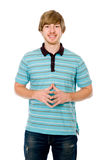 The young man smiles and looks into the camera. Stock Photography