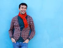 Young man smiling against blue background Royalty Free Stock Photo