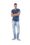 Young man smiling arms crossed Stock Photography