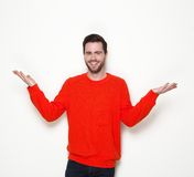 Young man smiling with arms raised Royalty Free Stock Photography