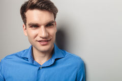 Young man smiling away from the camera. Royalty Free Stock Photography